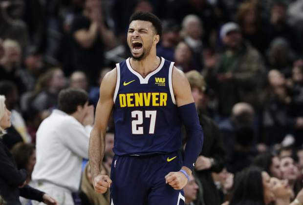 Denver Nuggets guard Jamal Murray (27) celebrates a score against the San Antonio Spurs during the second half of an NBA basketball game, in San Antonio, Monday, March 4, 2019. (AP Photo/Eric Gay)