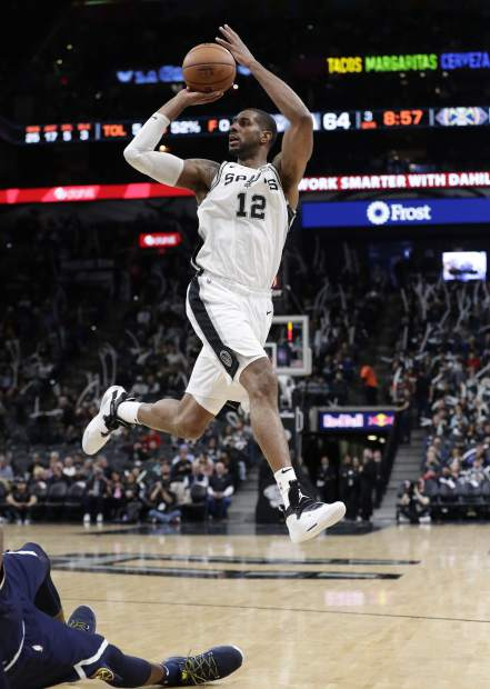 San Antonio Spurs center LaMarcus Aldridge (12) shoots against the Denver Nuggets during the second half of an NBA basketball game, in San Antonio, Monday, March 4, 2019. (AP Photo/Eric Gay)
