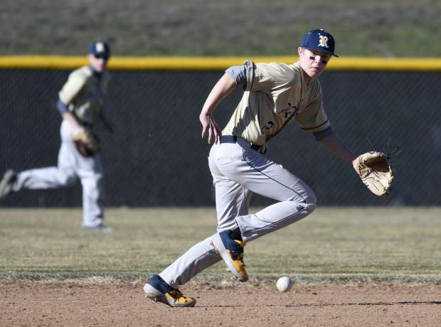 Rifle's Derek Wagler chases down a grounder up the middle during third-inning-action last Wednesday in New Castle.