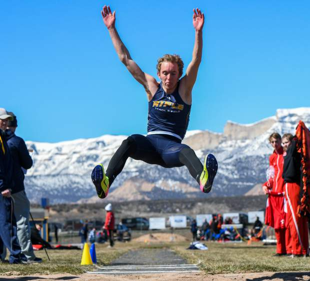 Rifle junior Tanner Cotner flies through the air in the long jump at the Rifle Invitational March 15 at Bears Stadium.