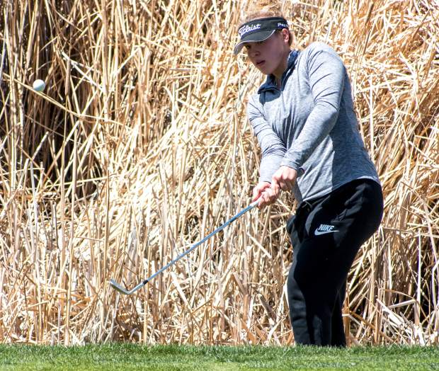 Rifle junior Masi Smith watches her chip shot onto the green roll towards the hole during the Coal Ridge Invitational at Lakota Canyon Golf Club in New Castle last season.