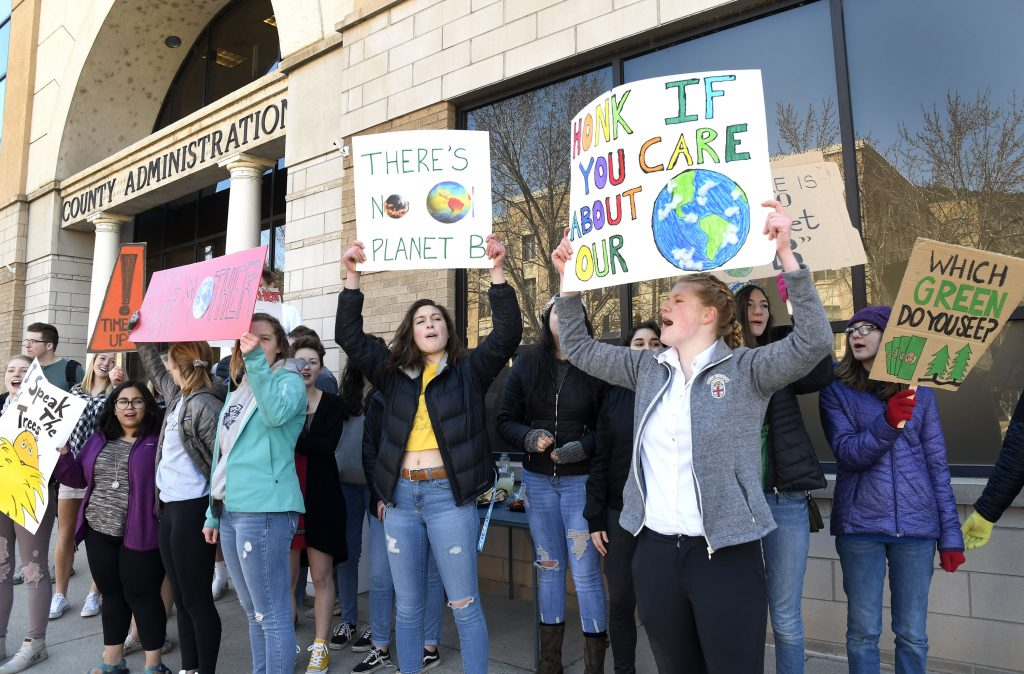 Students protest at the Garfield County Administration Building Friday in Glenwood Springs. The march and protest was organized by senior Hannah Juul, who was inspired to join students around the world in protesting climate change.
