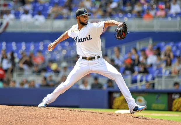 Miami Marlins starting pitcher Sandy Alcantara throws during the first inning of a baseball game against the Colorado Rockies, Sunday, March 31, 2019, in Miami.(AP Photo/Gaston De Cardenas)