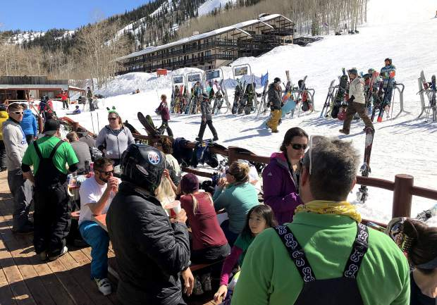 Visitors to Sunlight Mountain soak up the sun on the deck as they relax on another bluebird Colorado day.