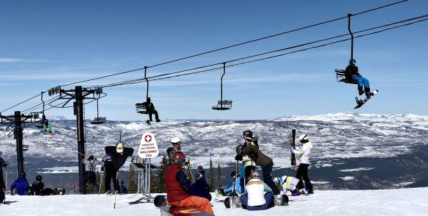 Skiers and riders congregating a top Sunlight Mountain are greeted by blue skies for another day of spring skiing on the Western Slope.