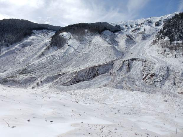 The avalanche scoured the snow to the ground in K Chutes, left, and Five Fingers. Hundreds if not thousands of mature trees were uprooted.