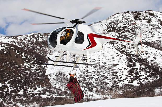 A helicopter crew contracted by Colorado Parks and Wildlife transports a pregnant cow elk last week as part of a study on the Avalanche Creek Elk Herd.