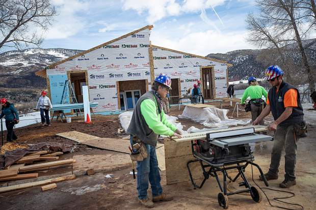 Construction on the Basalt Vista Affordable Housing project with Habitat for Humanity on Feb. 28. Volunteers Trent Marshall, right, and Jeff LaBaw use the table saw.