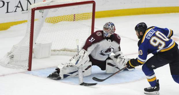 St. Louis Blues' Ryan O'Reilly (90) scores the winning goal in a shootout against Colorado Avalanche's Philipp Grubauer (31), of Germany, in an NHL hockey game, Monday, April 1, 2019, in St. Louis. (AP Photo/Bill Boyce)