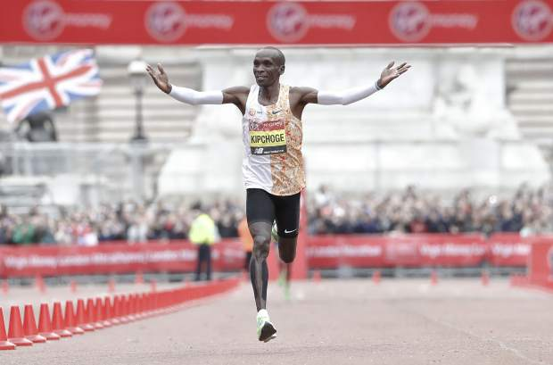 Kenya's Eliud Kipchoge wins the first place in the men's race at the 39th London Marathon in London, Sunday, April 28, 2019. (AP Photo/Alastair Grant)