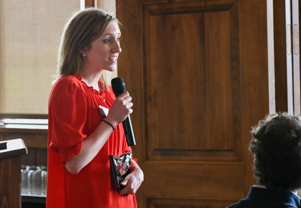 Kati Ledall is presented with the Athena Young Proessional Award during the ceremony held at Aspen Glen on Friday.