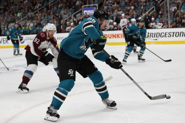Colorado Avalanche's Gabriel Landeskog (92) chases the San Jose Sharks' Logan Couture (39), as he moves the puck downice in the first period of Game 2 of an NHL hockey second-round playoff series at the SAP Center in San Jose, Calif., on Sunday, April 28, 2019. (AP Photo/Josie Lepe)