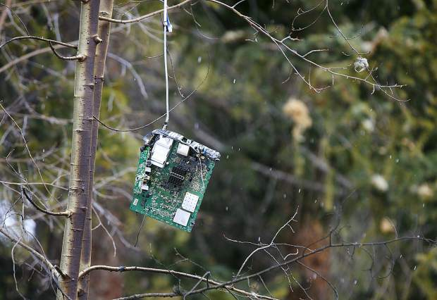 An electronic device hang in the tree at least 20 feet in the air as a result of the explosion Wednesday, April 3, along Royal Tiger Road in Breckenridge. Around 1:30 a.m. Wednesday, the house exploded to an apparent rupture in the home's gas line. Two people were sleeping inside and were only injured.