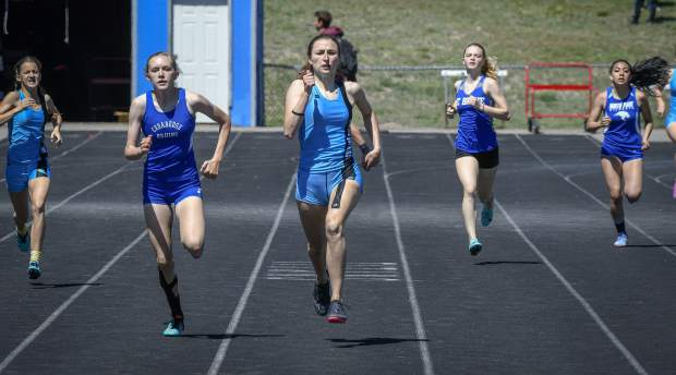 Coal Ridge's Kara Morgan leads the field down the straight away during her preliminary heat of the 400 meter dash Friday in New Castle.