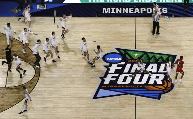 Virginia players celebrate after defeating Texas Tech 85-77 in the overtime in the championship of the Final Four NCAA college basketball tournament, Monday, April 8, 2019, in Minneapolis. (AP Photo/Morry Gash)