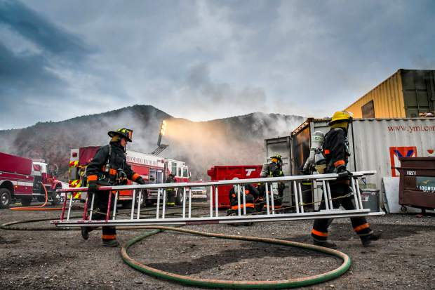 Colorado Mountain College students work their way around a building during a fire training at the Glenwood Springs Fire Department training grounds in South Glenwood near the airport.