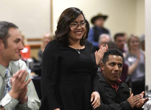Briana Rodriguez Cruz is all smiles after Garfield County Commissioner Mike Samson announced her as one of the three recipients of the 2019 Humanitarian Service Awards Monday in Rifle.