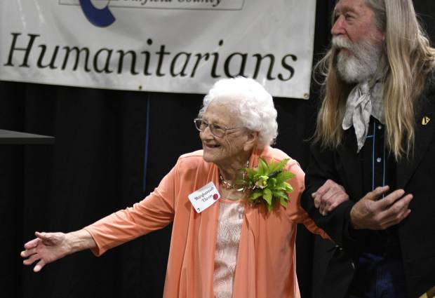 Longtime community volunteer Maryhannah Throm, 92, receives a standing ovation after Garfield County Commissioner John Martin presented her with one of three 2019 Humanitarian Service Awards Monday at Grand River Health in Rifle.