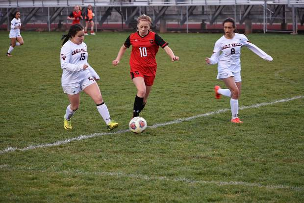 Glenwood Springs sophomore Tatum Lily tries to outrun two Eagle Valley defenders during Thursday's 4A Western Slope League battle at Stubler Memorial Field.