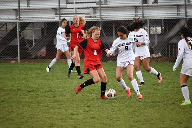 Glenwood Springs sophomore Tatum Lily battles for a loose ball with an Eagle Valley defender during the second half of Thursday's league matchup at Stubler Memorial Field.