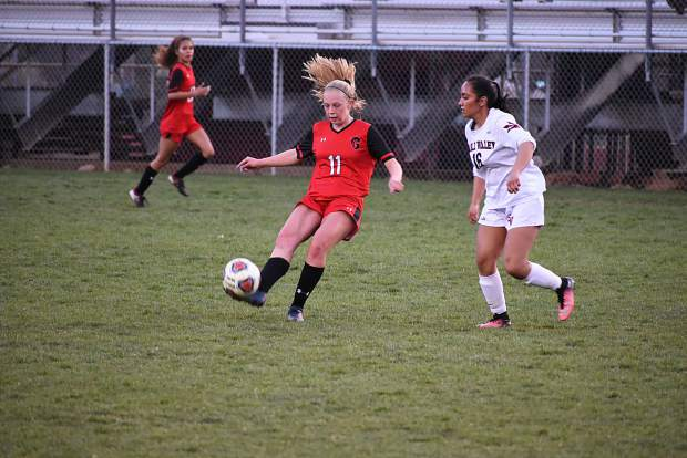 Glenwood Springs senior Levyn Thomas fires a cross into the box to a teammate during Thursday's 4A Western Slope League matchup with Eagle Valley at Stubler Memorial Field.