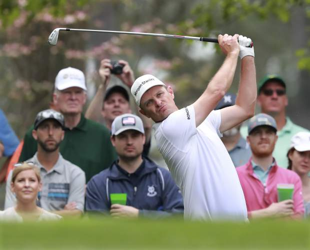Justin Rose hits his tee shot on the fourth hole during a practice round for the Masters golf tournament in Augusta, Ga., Monday, April 8, 2019. (Curtis Compton/Atlanta Journal-Constitution via AP)
