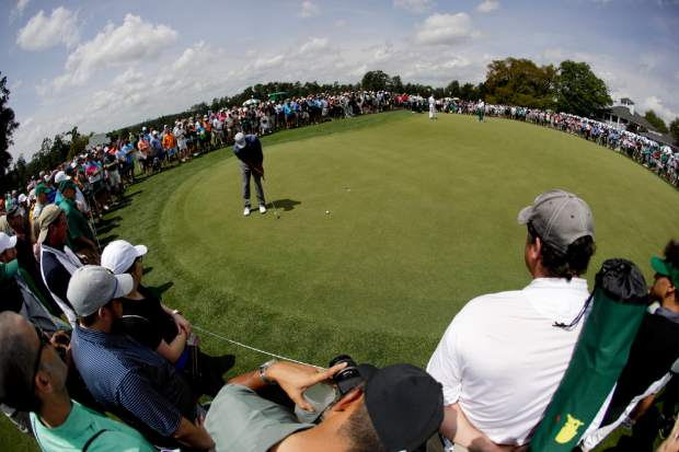 Tiger Woods putts on the practice green after a practice round for the Masters golf tournament Monday, April 8, 2019, in Augusta, Ga. (AP Photo/Charlie Riedel)