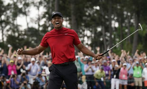 Tiger Woods reacts as he wins the Masters golf tournament Sunday, April 14, 2019, in Augusta, Ga. (AP Photo/David J. Phillip)