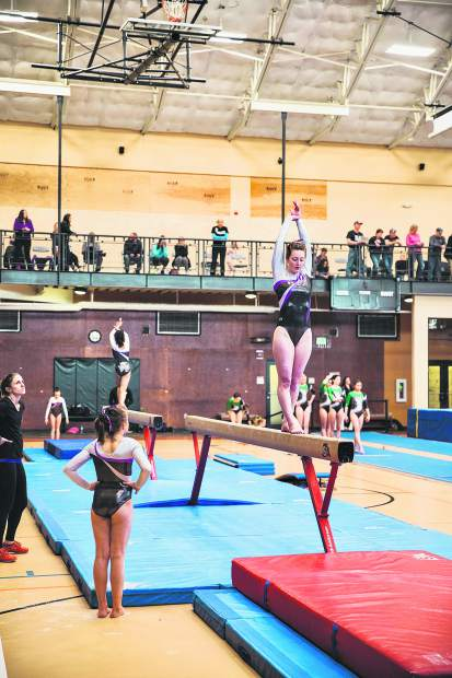 Juliet Mills attacks her balence beam routine in competition last week.