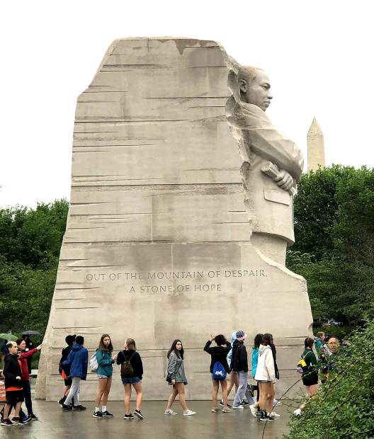 The Martin Luther King Jr. Memorial towers over students as they tour the memorial along the Tidal Basin near the National Mall in Washington D.C. The 30 foot monument which s carved in granite opned to the public in 2011.