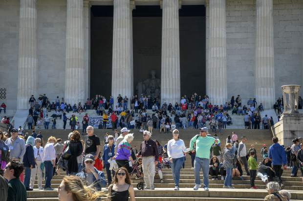 The steps of the Lincoln Memorial thrive with activity as tourists and locals enjoy a beautiful day in the nation's capital last week in Washington D.C.