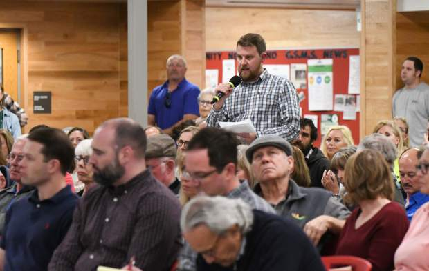 Members of the public ask questions while attending the Garfield County commissioners hearing Monday evening to address alleged permit violations for the Rocky Mountain Resources stone quarry near Glenwood Springs. The hearing was held at Glenwood Springs Middle School to accommodate the large crowd..