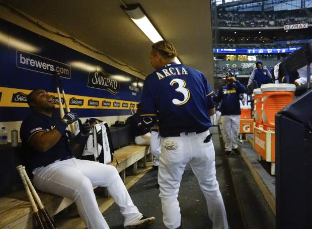 Milwaukee Brewers' Jesus Aguilar celebrates his three-run home run with Orlando Arcia (3) during the first inning of a baseball game against the Colorado Rockies Monday, April 29, 2019, in Milwaukee. (AP Photo/Morry Gash)