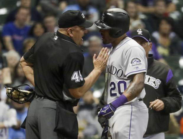Colorado Rockies' Ian Desmond argues with home plate umpire Jeff Nelson during the fifth inning of a baseball game against the Milwaukee Brewers Monday, April 29, 2019, in Milwaukee. (Desmond was ejected from the game. AP Photo/Morry Gash)