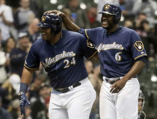 Milwaukee Brewers' Jesus Aguilar celebrates his three-run home run with Lorenzo Cain (6) during the first inning of a baseball game against the Colorado Rockies Monday, April 29, 2019, in Milwaukee. (AP Photo/Morry Gash)