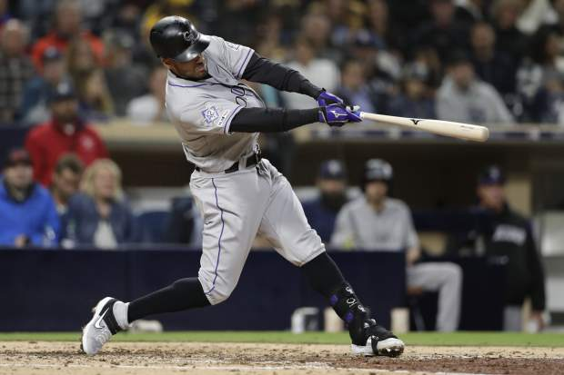 Colorado Rockies' Ian Desmond hits a home run during the seventh inning of a baseball game against the San Diego Padres, Monday, April 15, 2019, in San Diego. (AP Photo/Gregory Bull)