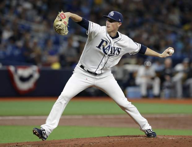 Tampa Bay Rays relief pitcher Ryan Yarbrough delivers to the Colorado Rockies during the third inning of a baseball game Monday, April 1, 2019, in St. Petersburg, Fla. (AP Photo/Chris O'Meara)