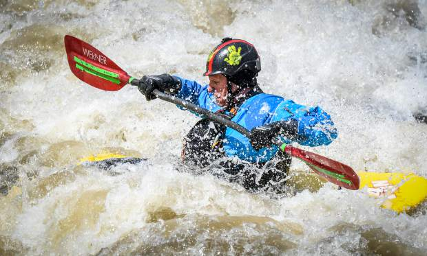A kayaker rides the wave at the Glenwood Springs Whitewater Park in West Glenwood on a sunny and warm Monday afternoon.