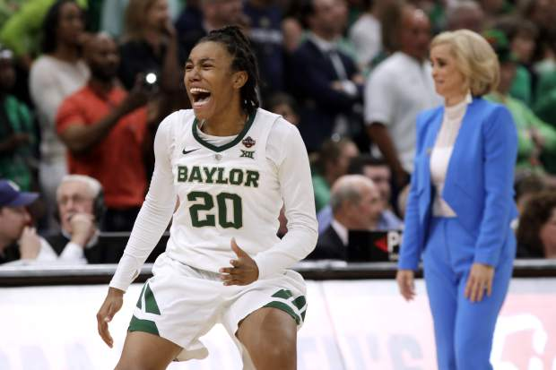 Baylor guard Juicy Landrum (20) celebrates during the waning seconds of the Final Four championship game against Notre Dame in the NCAA women's college basketball tournament, Sunday, April 7, 2019, in Tampa, Fla. Baylor coach Kim Mulkey is at right. Baylor won 82-81. (AP Photo/Chris O'Meara)