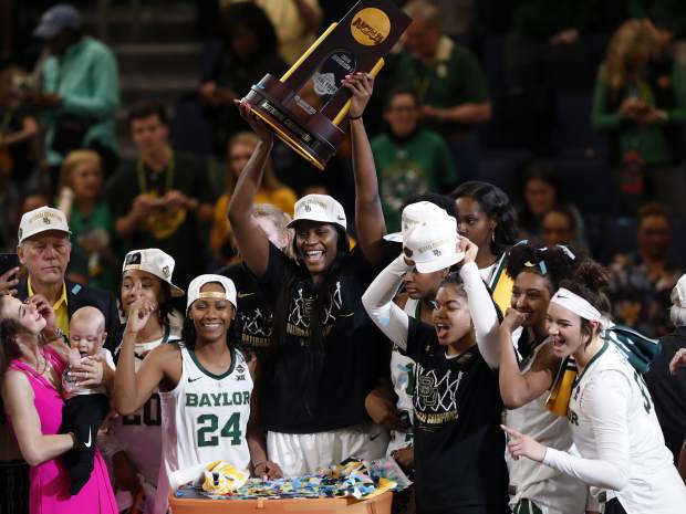 The Baylor team celebrates with the championship trophy after defeating Notre Dame 82-81 in the NCAA women's college basketball tournament Final Four title game Sunday, April 7, 2019, in Tampa, Fla. (AP Photo/Mark LoMoglio)