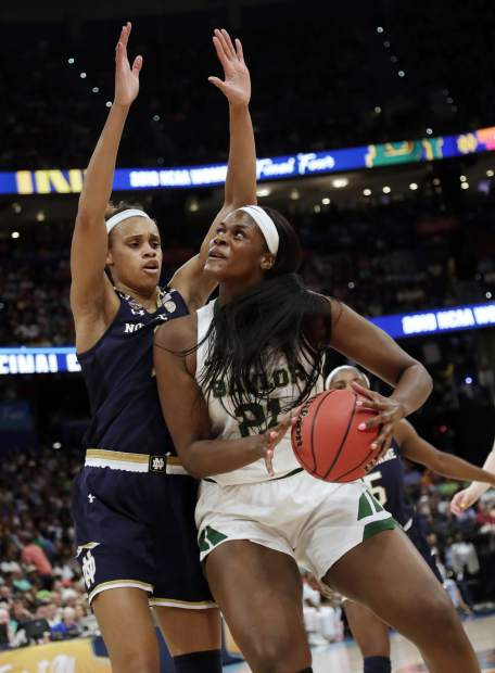 Baylor center Kalani Brown (21) drives to the basket as Notre Dame forward Brianna Turner defends during the first half of the Final Four championship game of the NCAA women's college basketball tournament Sunday, April 7, 2019, in Tampa, Fla. (AP Photo/John Raoux)