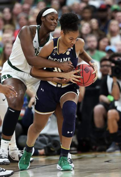 Baylor center Kalani Brown, left, and Notre Dame center Mikayla Vaughn (30) go after a loose ball, during the first half of the Final Four championship game of the NCAA women's college basketball tournament, Sunday, April 7, 2019, in Tampa, Fla. (AP Photo/John Raoux)