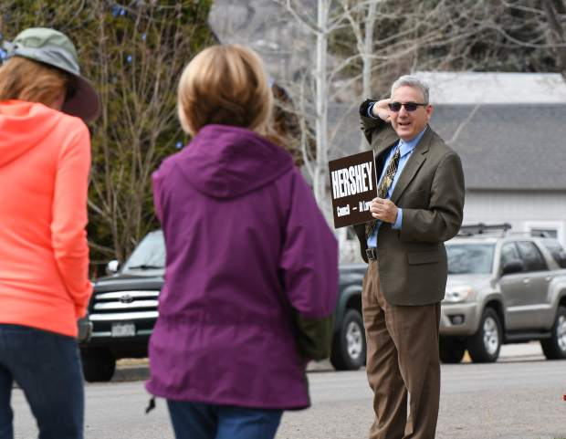 Tony Hershey does one last extra push of campaigning at the corner of 11th and Pitkin as parents pick up their kids at Glenwood Springs Elementary School on Tuesday afternoon.