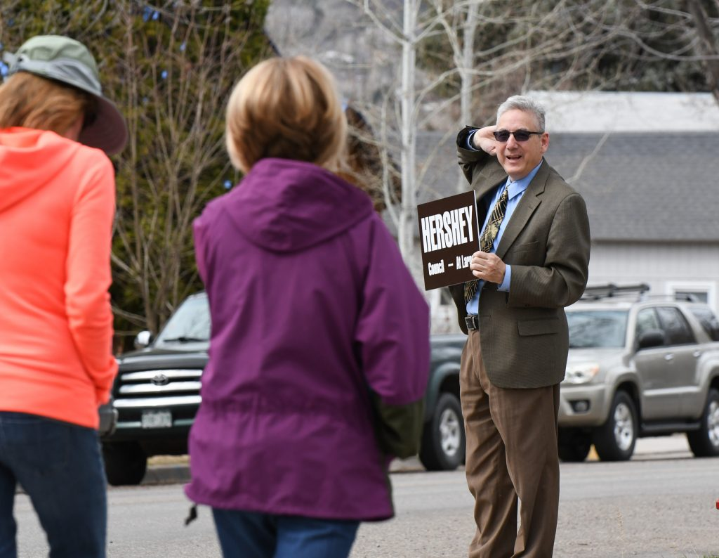 Tony Hershey does one last extra push of campaigning at the corner of 11th and Pitkin as parents pick up their kids from school at Glenwood Springs Elementary School on Tuesday afternoon. Hershey won election to the at-large City Council seat over Jim Ingraham and Erika Gibson.