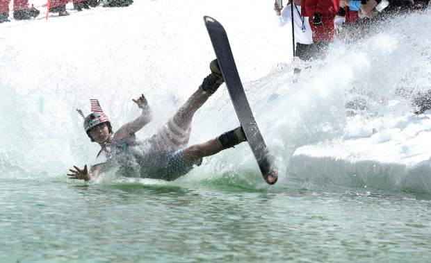 A competitor can't keep his feet under him as he crashes into the water during Sunday's competition.