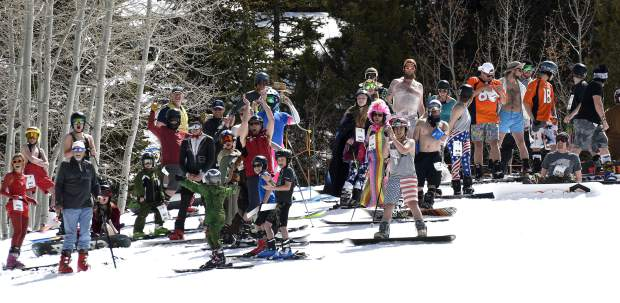 Competitors wait for their turn to try the traditional pond skim on Sunlight Mountain's final day of the season Sunday.