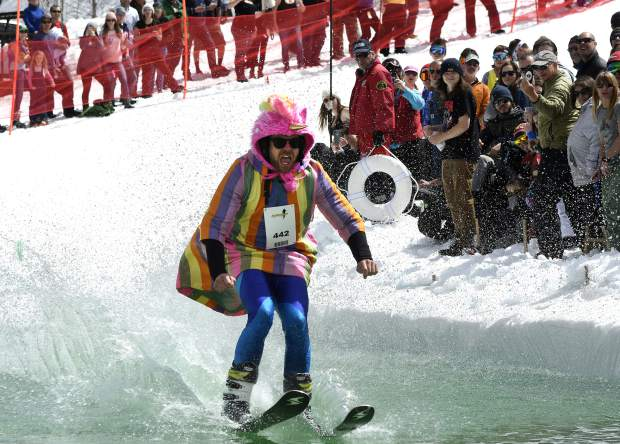 Shane Spyker of Glenwood Springs skims across the manmade pond near the base of Sunlight Mountain Sunday.The resort celebrated the close of the season, bringing back the pond skim after a three-year hiatus.