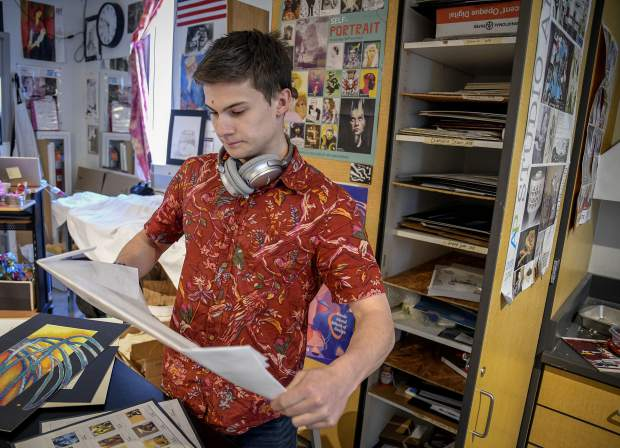 Ethan Hibbard, a senior at Glenwood Springs High School, goes through his art work as he prepares for the 30th annual GSHS Fine Arts Week that kicks off Monday.