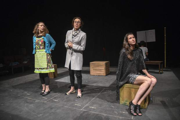 Ensemble members Trary Maddalone LaMee, Julie Pickrell, Cassidy Willey, and Gabriela Alvarez Espinoza walk through a scene for the Women's Voices Project earlier this week at TRTC in Carbondale.