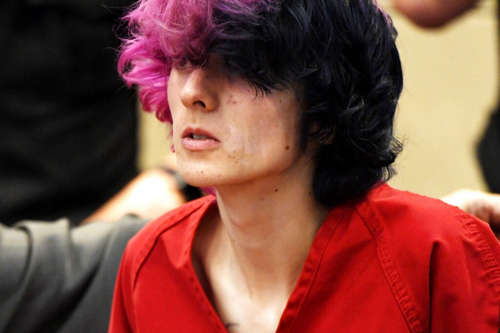 FILE - In this Wednesday, May 8, 2019 file photo, Devon Erickson, an accused STEM School shooter, appears at the Douglas County Courthouse in Castle Rock, Colo. Erickson and another suspect in the suburban Denver school shooting are due back in court as prosecutors file charges in the violent attack that killed a student and wounded multiple others. Prosecutors also are expected to decide Friday, May 10, whether to charge the younger suspect, Maya McKinney, 16, as an adult. (Joe Amon/The Denver Post via AP, Pool, File)